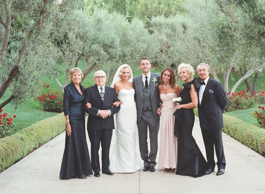 Simone Harouche in a strapless Carolina Herrera gown, groom in a grey Tom Ford suit with family
