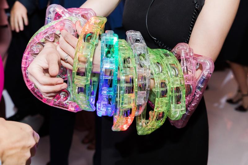 colorful plastic tambourines on dance floor during wedding reception