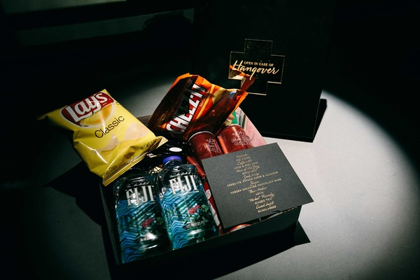 a couples hangover box for guests with snacks water and other items