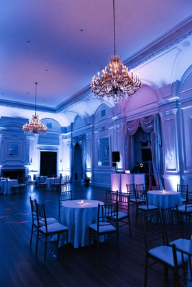 Ballroom at Oheka Castle with chandeliers and bright blue violet lighting DJ booth wedding ideas