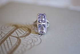 Bride's two-stone, emerald-cut amethyst ring