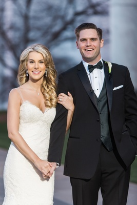 Josh and Allie smile for the camera bride in Ines Di Santo wedding dress groom in tuxedo and bow tie