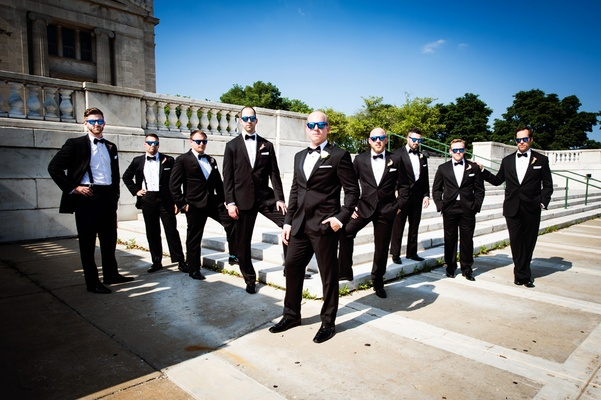 groom in vera wang, groomsmen in men's wearhouse pose wearing sunglasses
