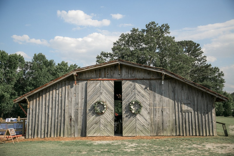 Wedding Reception Barn Venue Sliding Doors With Wreaths And Old Wood Siding North Carolina