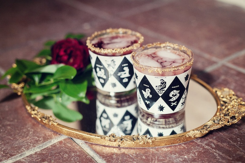 Wedding reception cocktails in glasses with a black and white pattern, zodiac signs