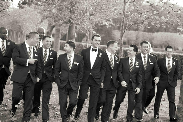 Black and white photo of men in tuxedos and ties