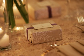 Ecru and white paper box tied with ribbon