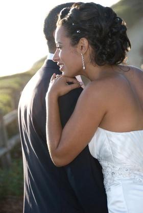 Bride wears diamond drop earring