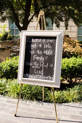 chalk sign outside ceremony silver metallic frame outdoors garden dallas texas #NilousGotRothermeled