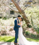 bride in wedding dress hair in low bun updo groom in navy suit brown shoes lodge at torrey pines