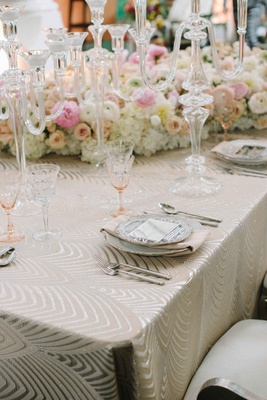 luxe linen cream cleopatra, crystal candelabra, peach glassware colored glassware