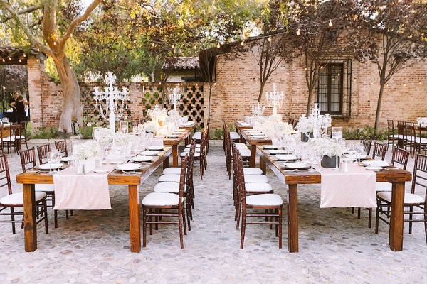 outdoor ranch wedding with neutral sparkling d cor in