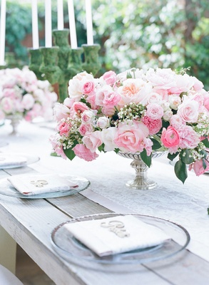 Wedding centerpiece light pink rose, garden rose, ranunculus flowers candelabrum in moss