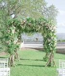 destination wedding florence italy greenery white pink flowers white chairs italian countryside