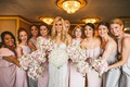 bride in illusion neckline wedding dress bridesmaids in silver pink grey mismatch dresses