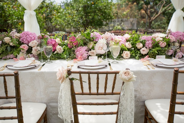 bridal shower with pastel flower arrangements and lace vintage inspired details