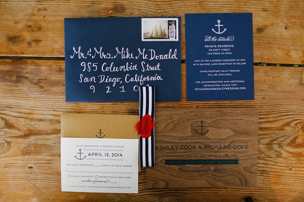 Navy blue envelope with anchor motif and wood wedding invitation