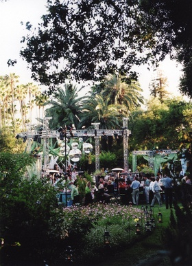 Concert-like stage for band and dance floor at outdoor reception
