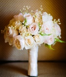 white and blush bridal bouquet with traditional and garden roses, baby's breath