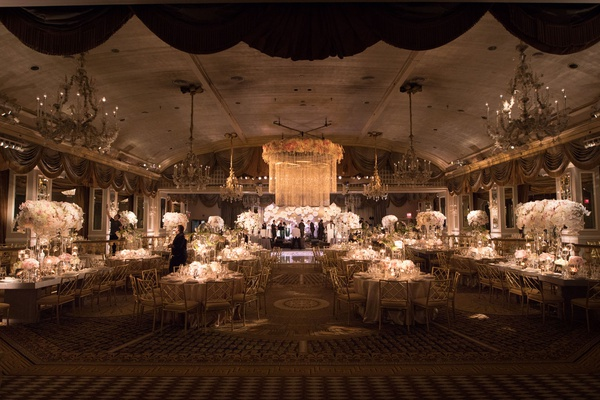 wedding reception ballroom at the pierre white pink flowers chandeliers floral chandelier