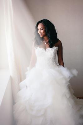 Amena Jefferson in Lazaro lace wedding dress