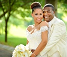 Megan Wollover in high bun and off the shoulder Ines Di Santo wedding dress and Tracy Morgan wedding