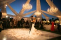 Bride and groom dancing on gobo lit dance floor