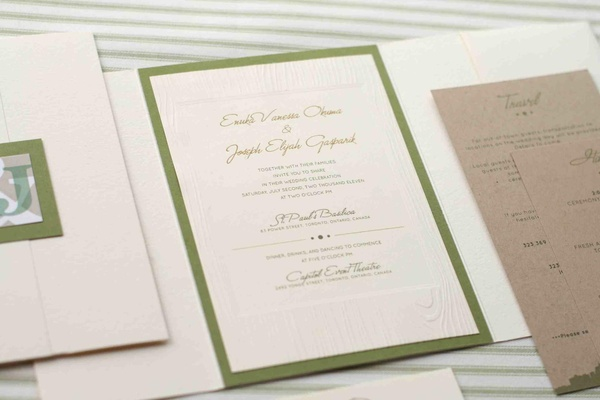 False wood wedding invite with green border and monogram