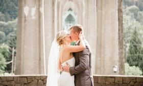 first kiss outdoor park ceremony portland bridal butt wedding rustic bride veil gray suit groom