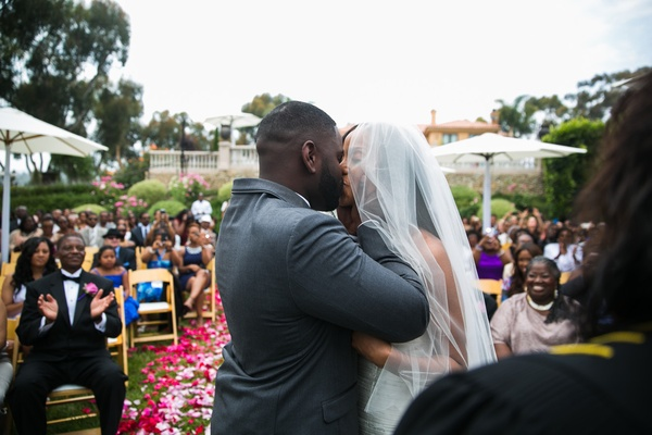 newlyweds share first kiss