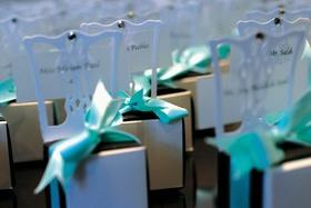 Tiffany blue box on top of mini white chair wedding favor