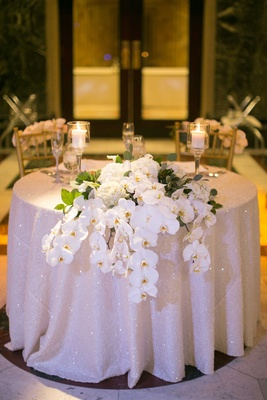 sparkling ivory sweetheart table linen wedding orchids centerpiece classic feminine