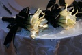 White calla lilies tied with black ribbon for bridesmaids