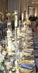 Tall vases filled with flowers and floating candles