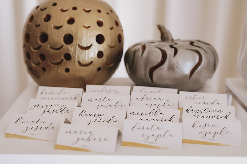 Fall wedding ideas escort cards white gold calligraphy gold silver pumpkin decorations