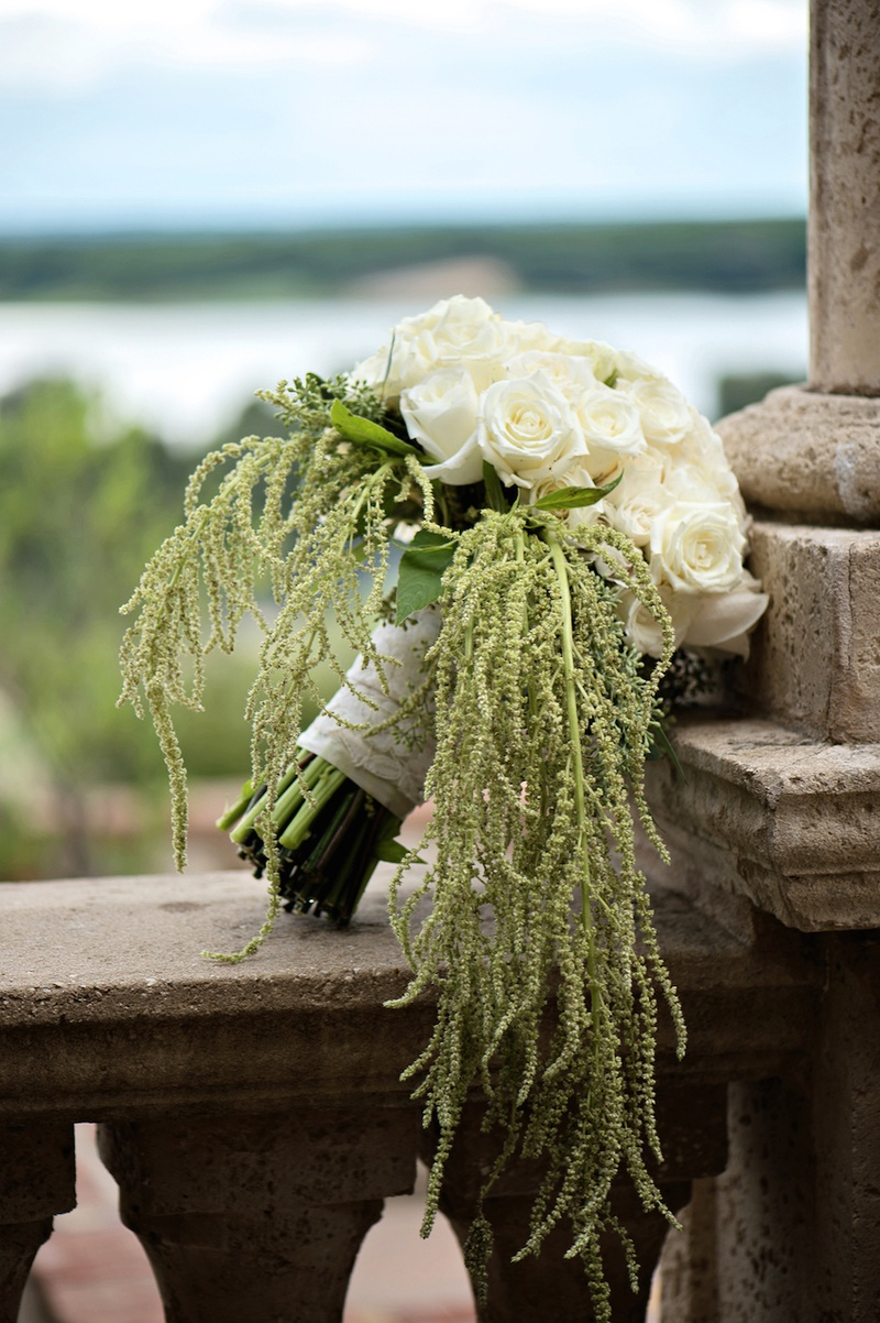 White and ivory roses with green amaranthus for bouquet
