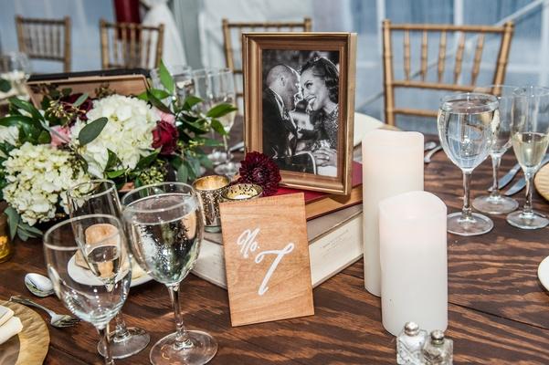 wedding centerpieces books hydrangeas framed engagement photos pillar candles