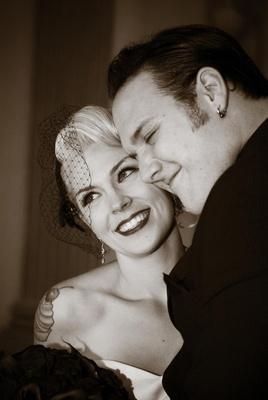 Black and white photo of Brandon Saller, drummer of Atreyu, and his bride