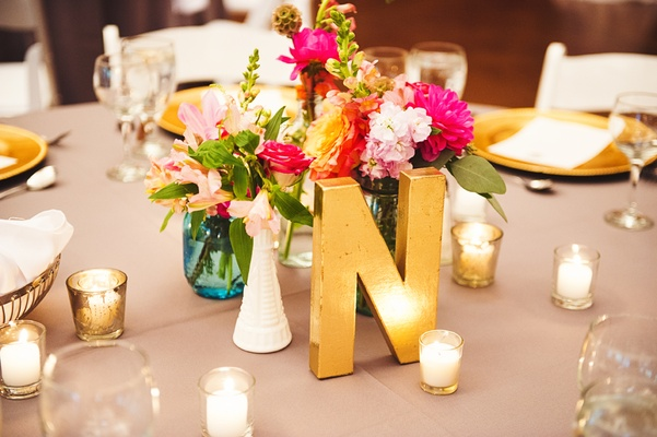 gold letter n and low pink floral arrangements