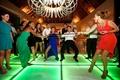 Actress Eva Longoria and host Mario Lopez dancing