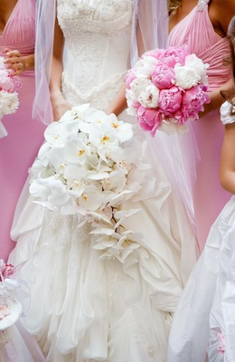 White bridal bouquet and pink bridesmaid nosegays