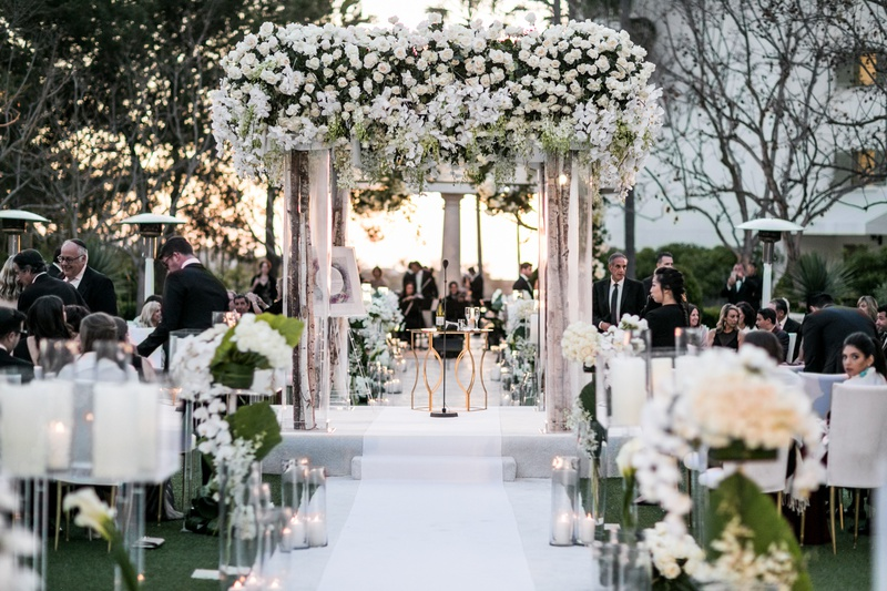 Wedding ceremony romantic white aisle runner candles white flowers birch in the round seating