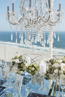 Mirrored table with pillar candles and chandelier