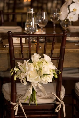 Chair decoration on back of wedding reception seat