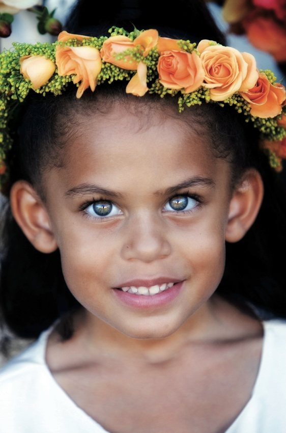 Headshot of flower girl with beautiful eyes and flower crown