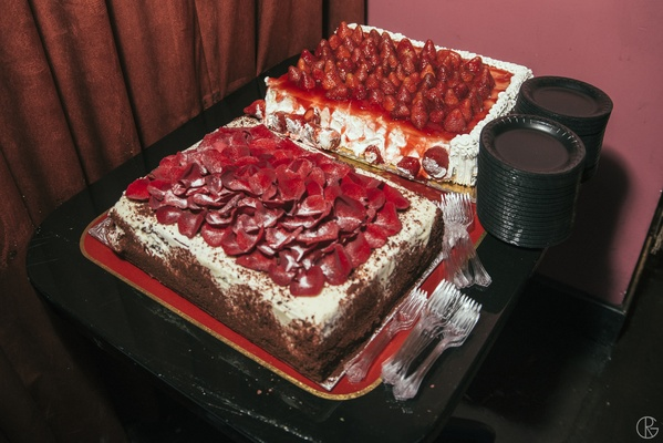 Two sheet cakes decorated with rose petals and strawberries