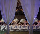 Wedding inspiration long table white flower centerpiece drapery drapes purple violet lighting