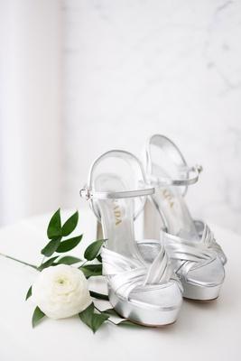 Prada silver platform wedding shoes with ankle strap ranunculus flower greenery