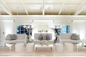 Tufted couches and mirrored tabletops