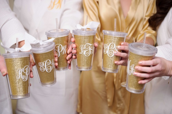 glittery gold drink tumblers with straws, bows, with monograms for bridesmaid gift